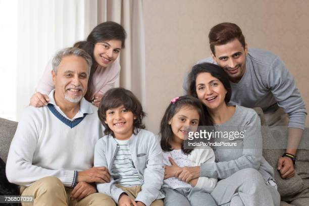 Portrait of smiling multi-generation family on sofa