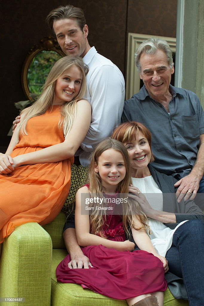 Portrait of smiling multi-generation family sitting on sofa : Stock Photo