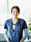 Portrait of smiling nurse standing in hospital