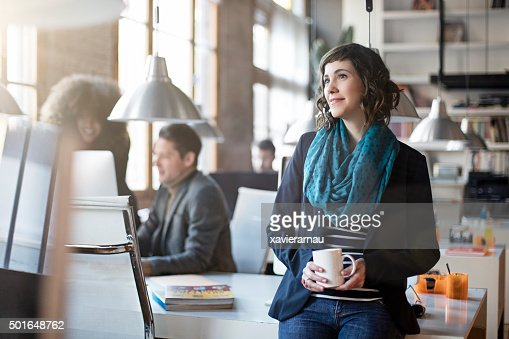Portrait of smiling office worker relax having a coffee