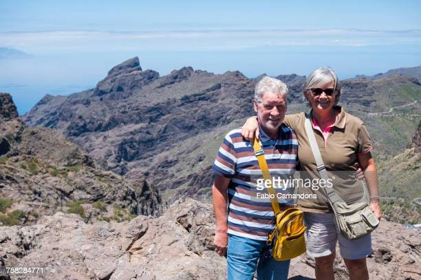 Portrait of smiling older Caucasian couple on mountain
