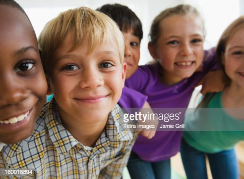 Portrait of smiling school children (8-9)