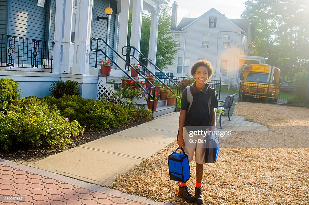 Portrait of smiling schoolgirl outside school