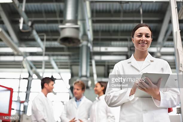 Portrait of smiling scientist with digital tablet