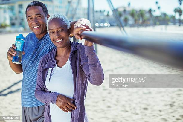 Portrait of smiling senior couple on beach playground