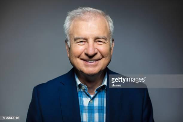 Portrait Of Smiling Senior Man Wearing Blazer