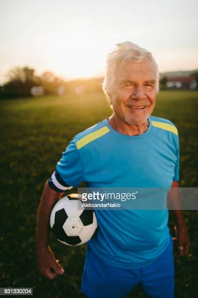 Portrait of smiling, senior soccer player