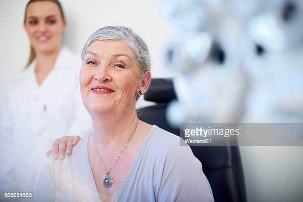Portrait of smiling senior woman at the eye doctor