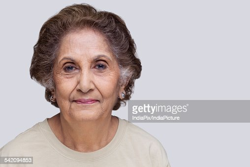 portrait of smiling senior woman photo getty images. Black Bedroom Furniture Sets. Home Design Ideas