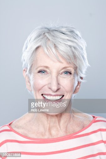 portrait of smiling senior woman studio shot photo getty images. Black Bedroom Furniture Sets. Home Design Ideas