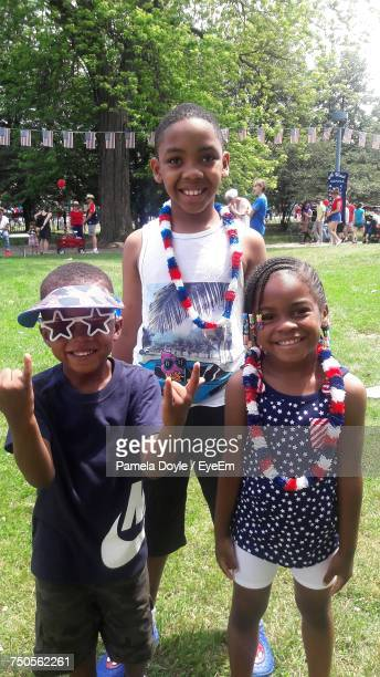 Portrait Of Smiling Siblings Standing At Nichols Park During Fourth Of July