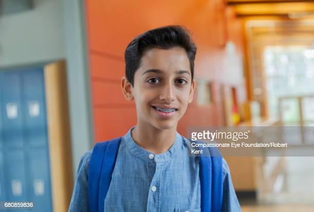 Portrait of smiling student in corridor