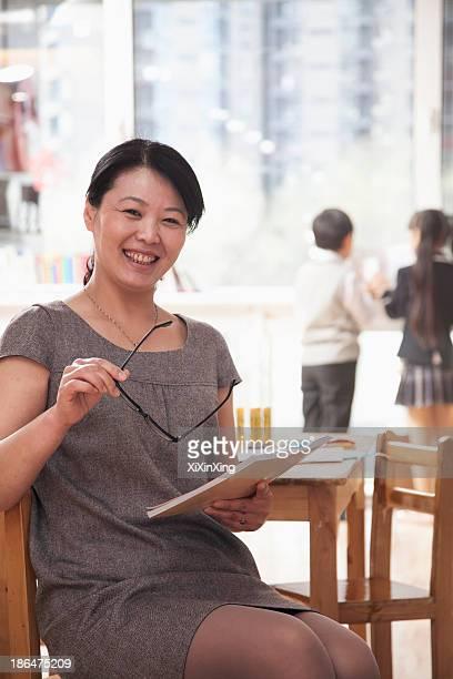 Portrait of smiling teacher in the classroom, Beijing