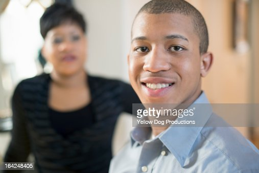 Portrait of Smiling Teen, Mom in background : Stock-Foto