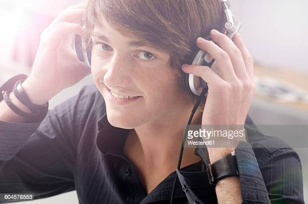Portrait of smiling teenage boy with headphones