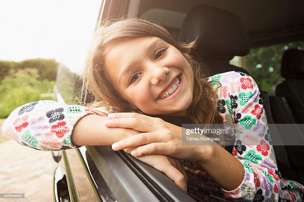 Portrait of smiling teenage girl (13-15) in car : Bildbanksbilder
