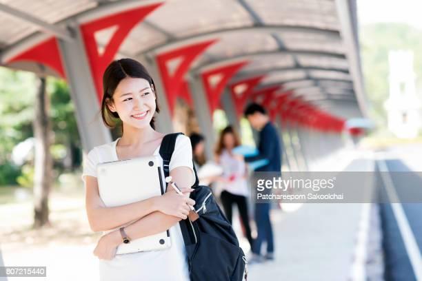 Portrait of smiling university asian student