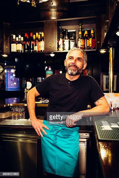 Portrait of smiling waiter in an Irish pub
