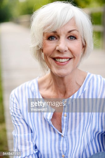 portrait of smiling white haired senior woman photo getty images. Black Bedroom Furniture Sets. Home Design Ideas