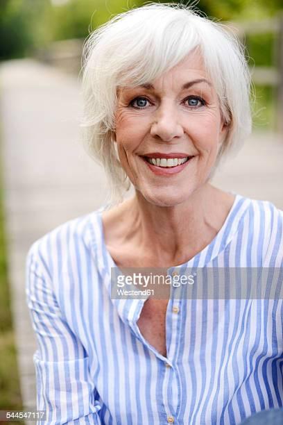 Portrait of smiling white haired senior woman