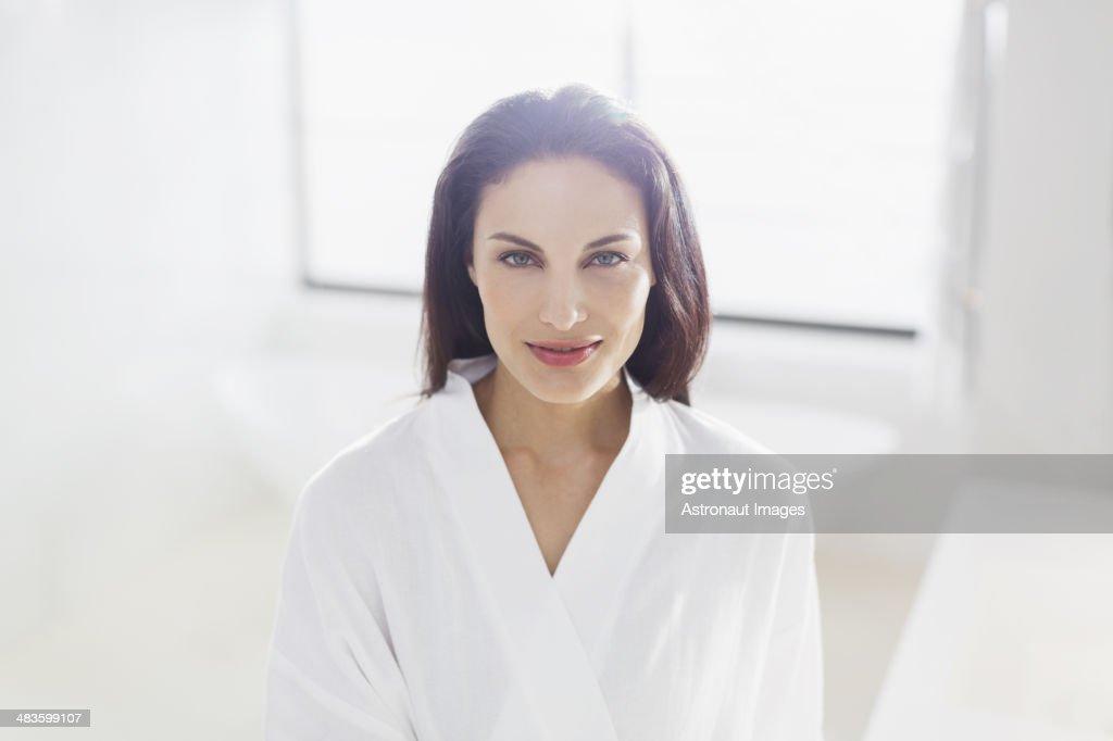 Portrait of smiling woman in bathrobe
