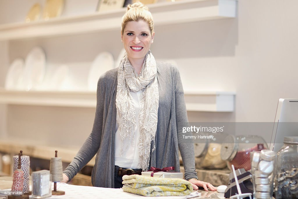 Portrait of smiling woman in restaurant : Stock Photo