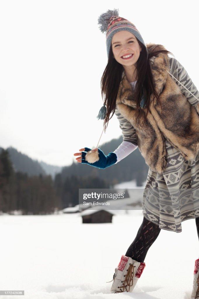 Portrait of smiling woman in snowy field : Stock Photo