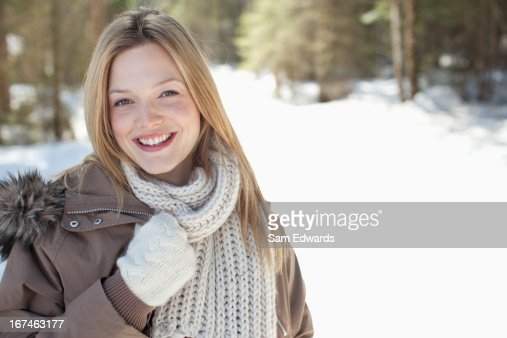 Portrait of smiling woman in snowy woods : Stock Photo