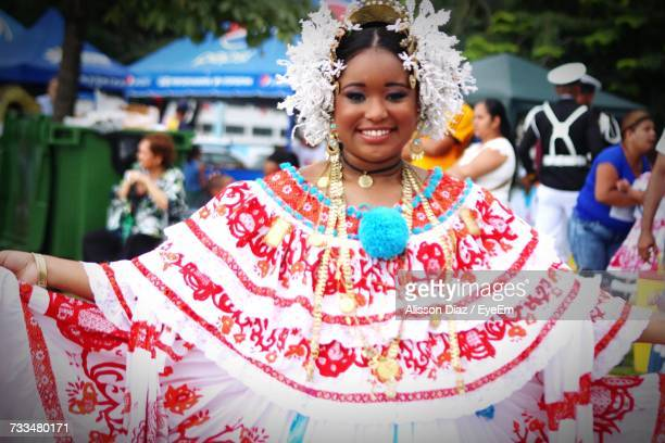 Portrait Of Smiling Woman In Traditional Cloth At Carnival