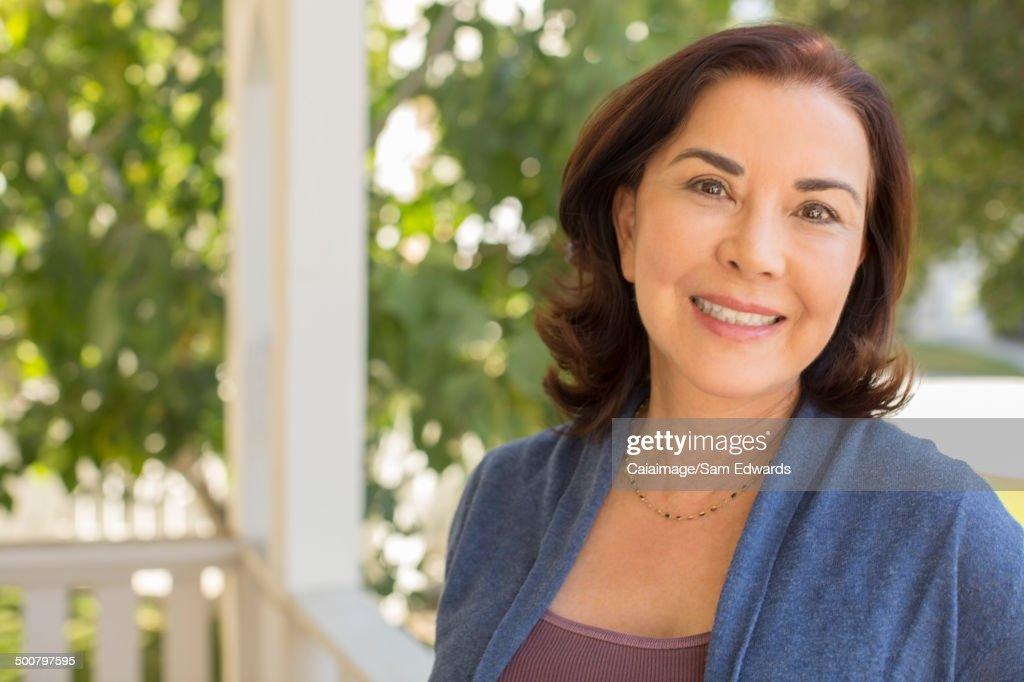 Portrait of smiling woman on porch