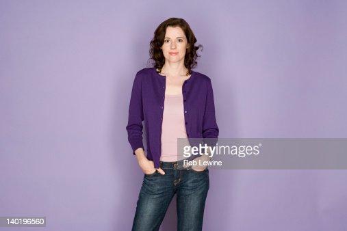 Portrait of smiling woman on purple background, studio shot