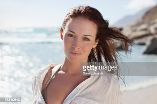 Portrait of smiling woman on sunny beach : Stock Photo