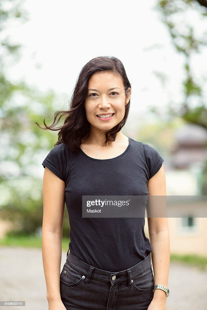 Portrait of smiling woman standing on street