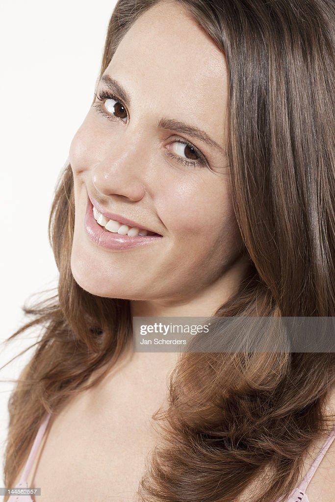 Portrait of smiling woman,  studio shot : Stock Photo