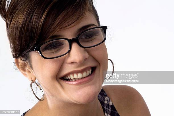Portrait of smiling woman wearing glasses, close-up