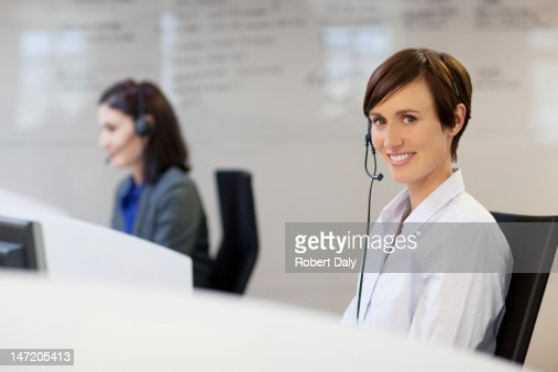 Portrait of smiling woman wearing headset : Stock Photo