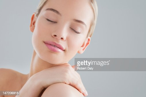 Portrait of smiling woman with eyes closed : Stock Photo