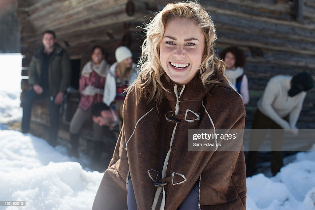 Portrait of smiling woman with friends in background : Stock Photo