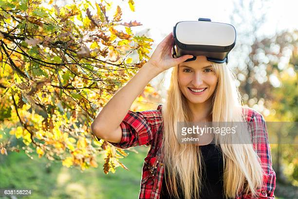 Portrait of smiling woman with Vr headset