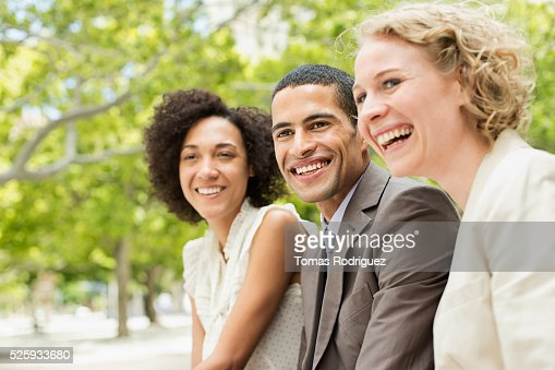 Portrait of smiling women and man : Photo