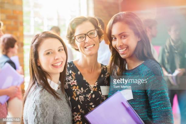 Portrait of smiling women in community center