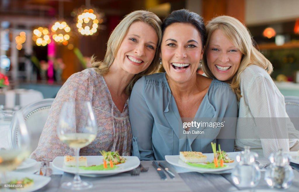 Portrait of smiling women in restaurant