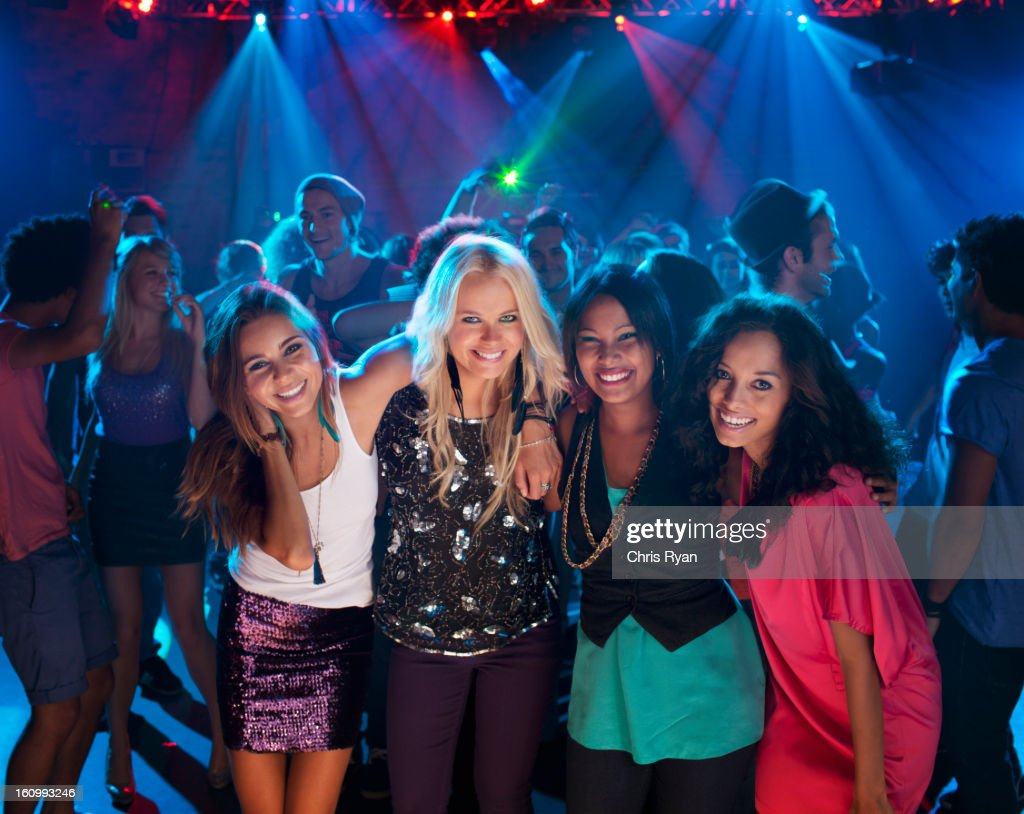 Portrait of smiling women on dance floor at nightclub : Stock Photo