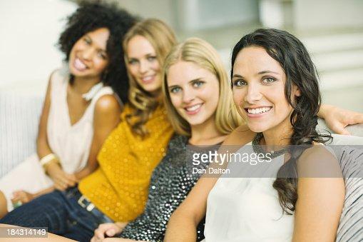 Portrait of smiling women on sofa