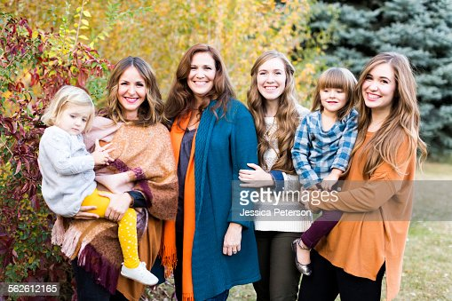 Portrait of smiling women with children (2-3, 4-5)