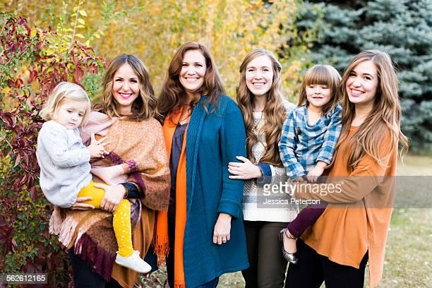 Portrait of smiling women with children (2-3, 4-5)