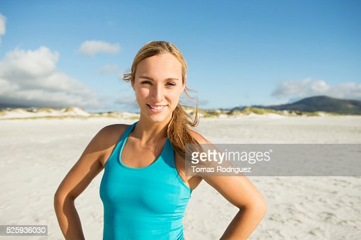 Portrait of smiling young adult woman : Stock Photo