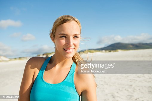 Portrait of smiling young adult woman : Stockfoto