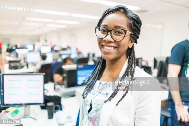 Portrait of smiling young entrepreneur in creative office