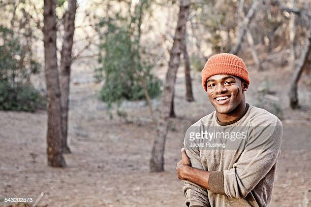 Portrait of smiling young man in forest